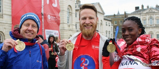 International Needs London Marathon runners with medals